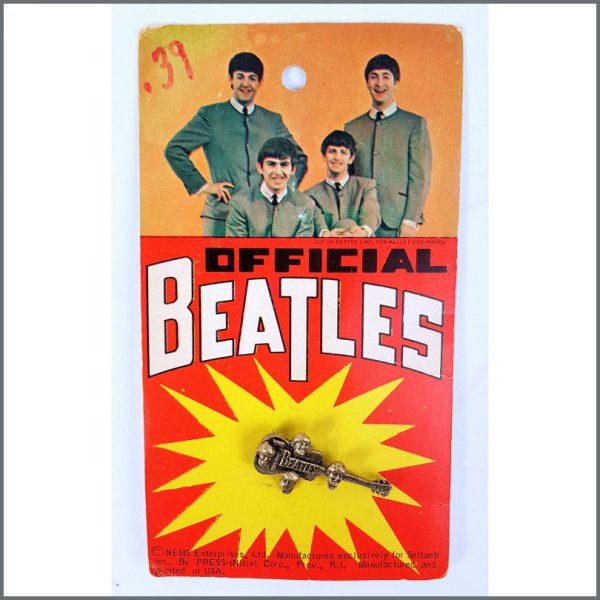 B26558 - The Beatles 1960s Seltaeb Inc Brass Pin Badge (USA)